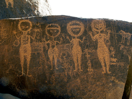 round-headed women with upraised hands, boulder petroglyph