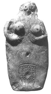 rough clay figurine of woman clasping breasts, with large dotted vulva