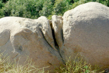 natural vulva rock formation enhanced by human hands