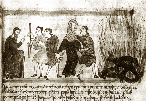 men leading veiled woman to a burning pyre, her feet off the ground
